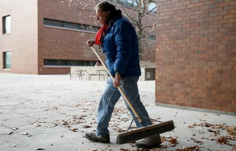 Sweeping leaves outside