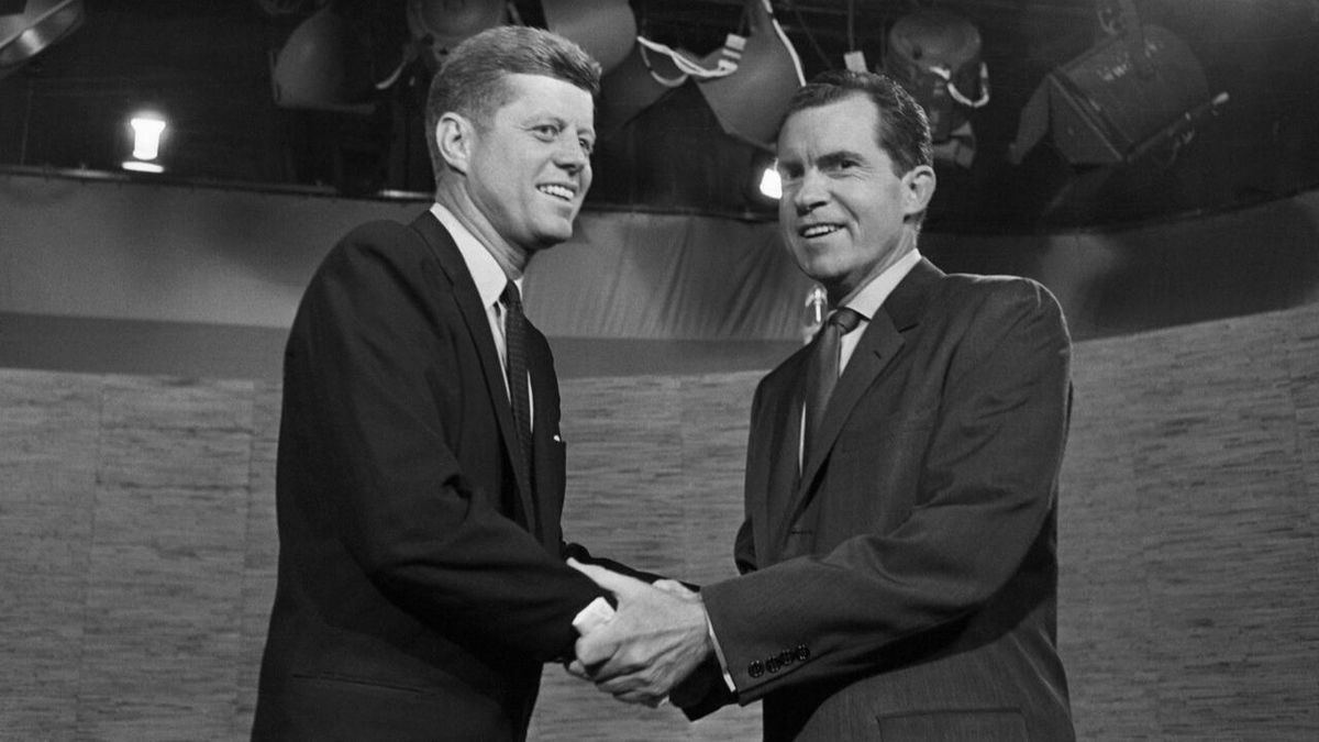 Presidential candidates John F. Kennedy and Richard Nixon shake hands after their televised debate