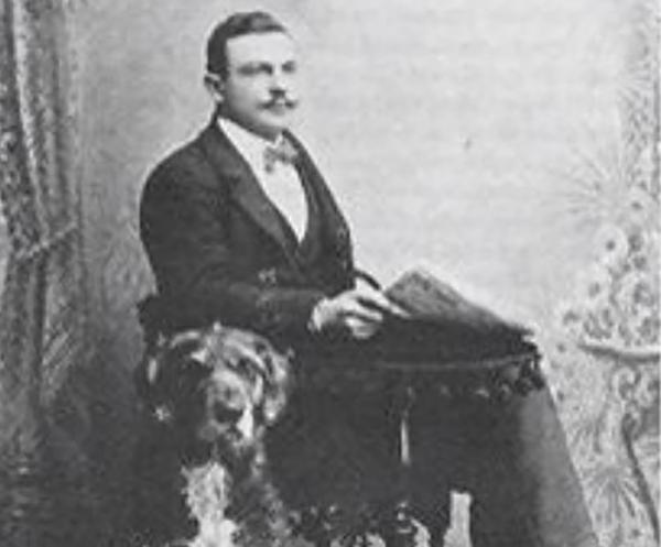 Man with extinct Dalbo Dog