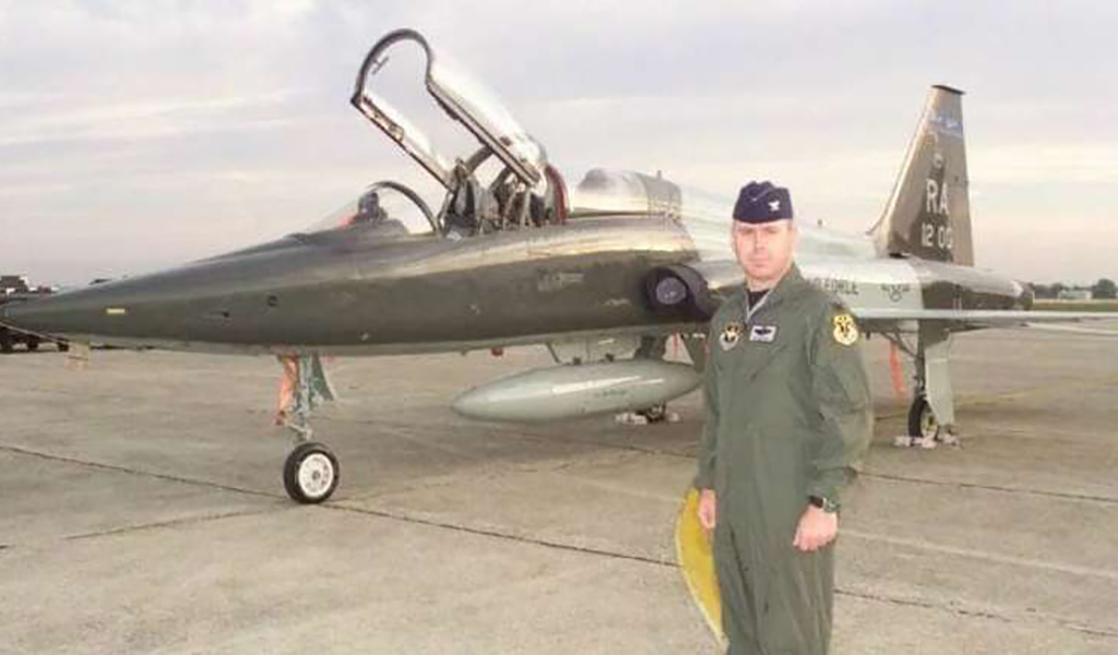 Colonel James Moschgat in front of plane