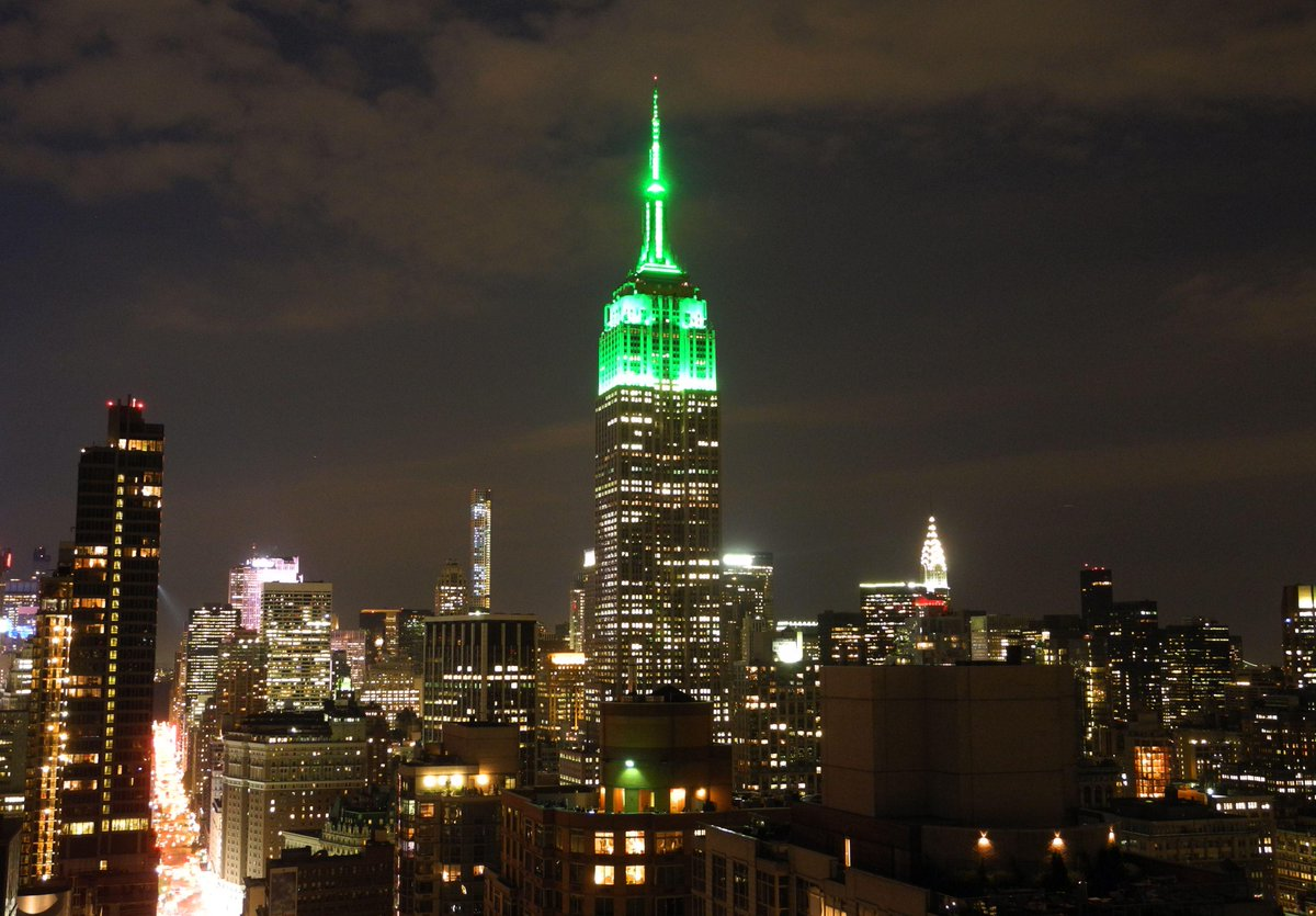 Empire State building lit up in green