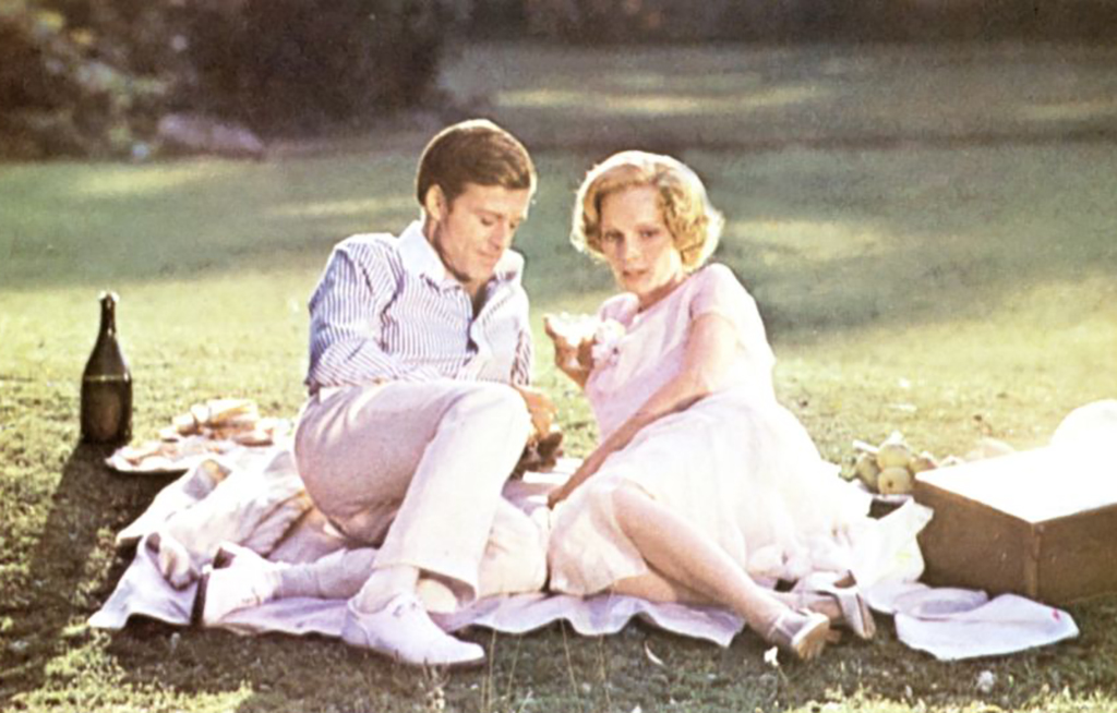 Mia Farrow and Robert Redford having a picnic -1137207144