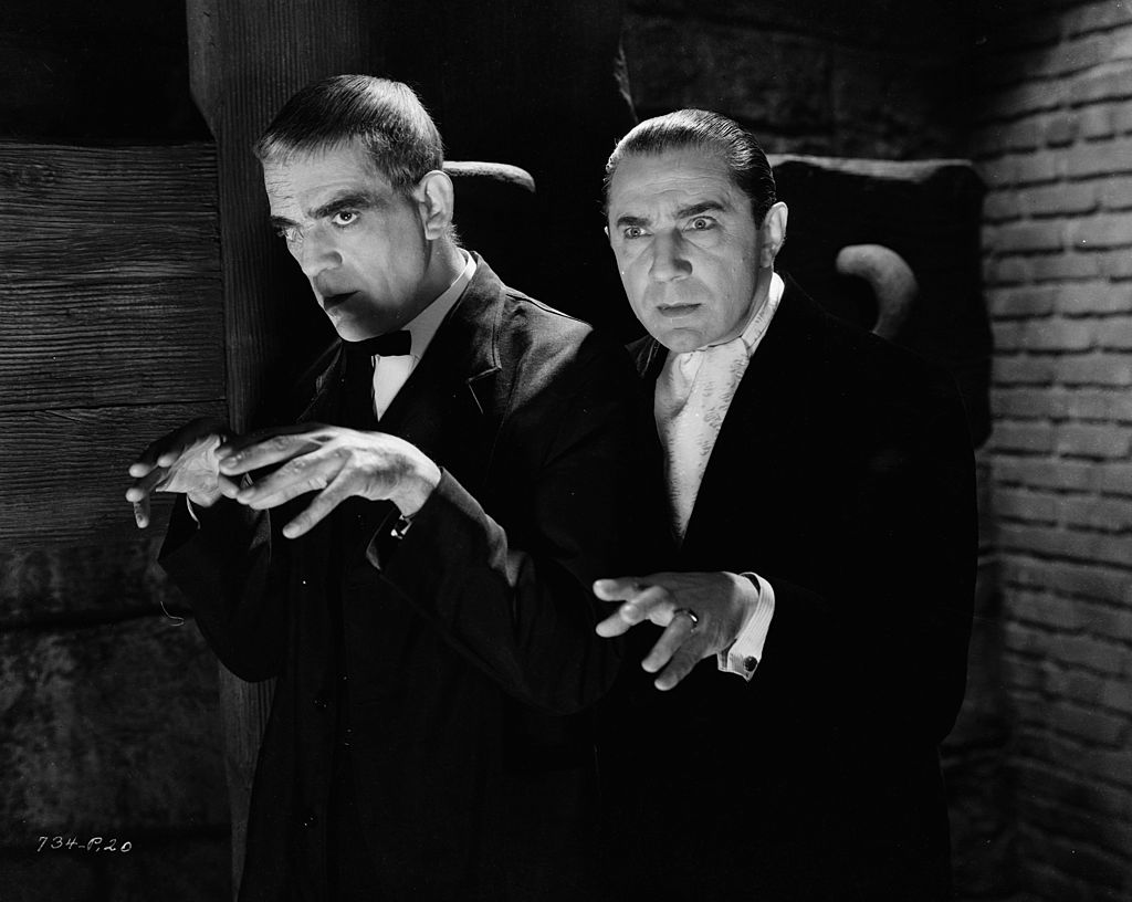 boris karloff posing for a picture with bela lugosi