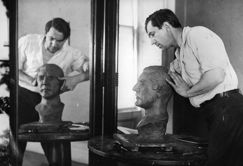 bela lugosi sculpting a bust of himself