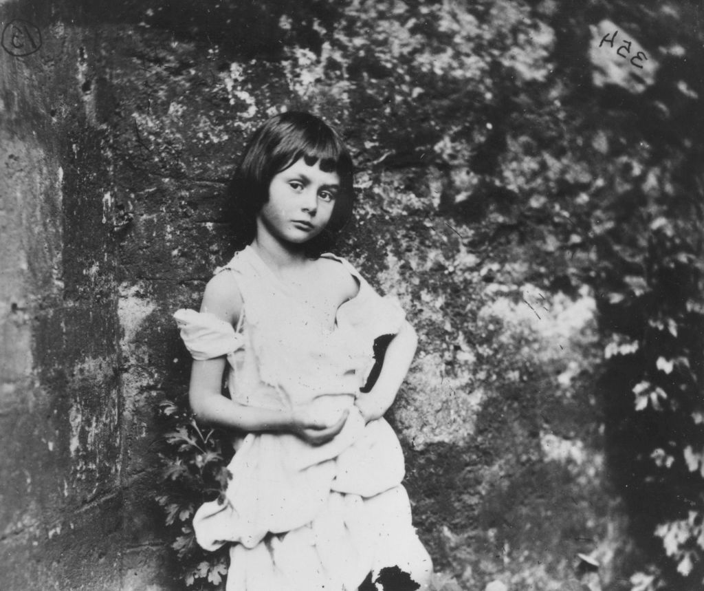A young Alice Liddell poses for Lewis Carroll to take her photo