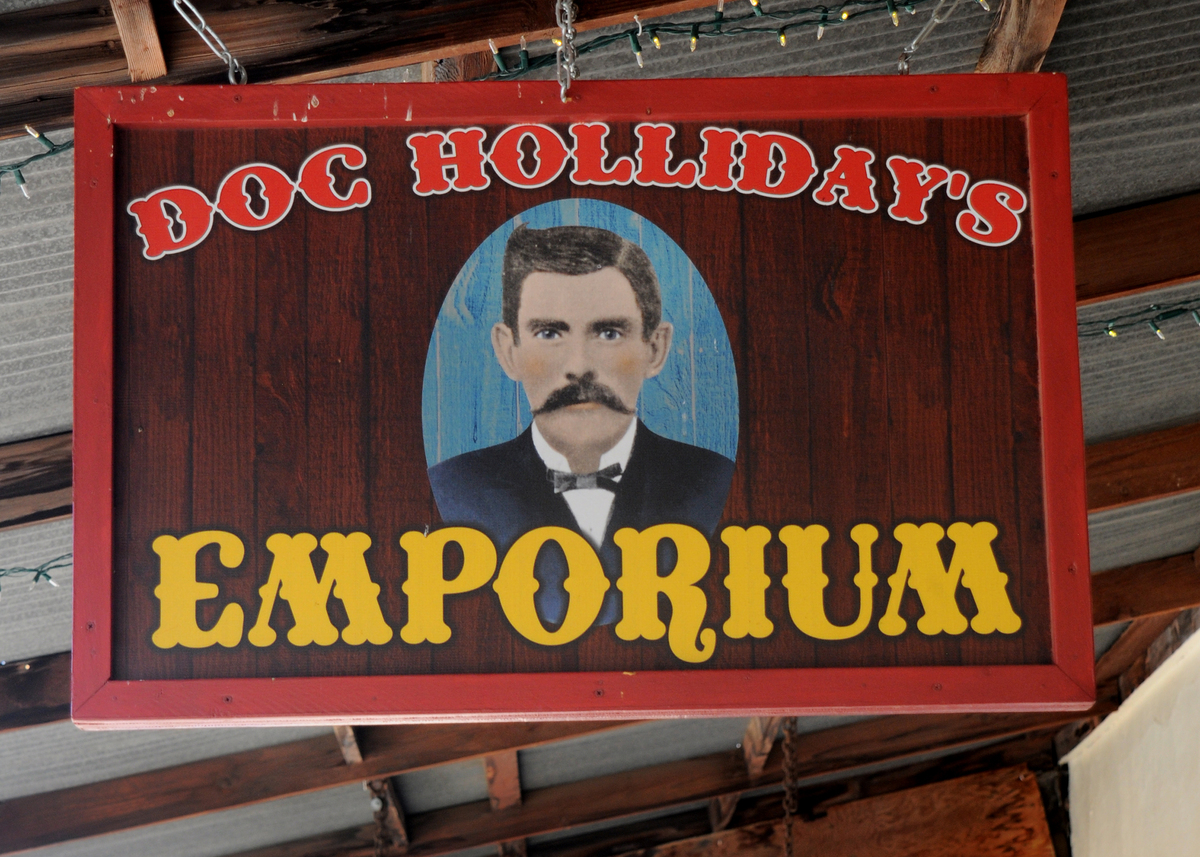 A sign hangs over the entrance to Doc Holliday's Emporium in historic Tombstone, Arizona, known as 'The Town Too Tough to Die.'