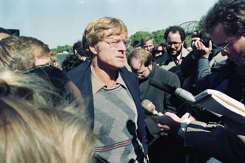 Redford talking to reporters