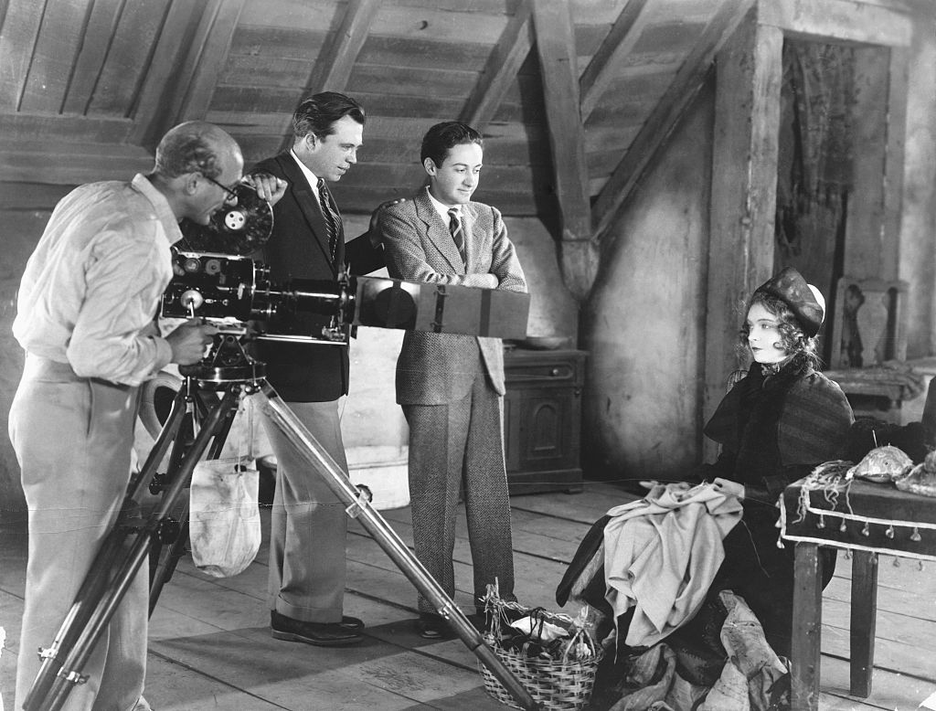 An actress looks into the camera while being filmed for a silent movie