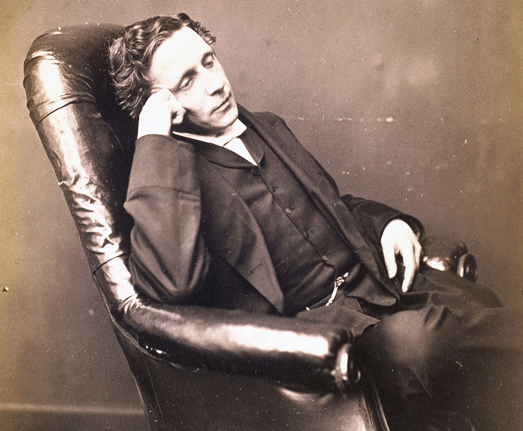 Lewis Carroll poses in a leather chair for a self portrait