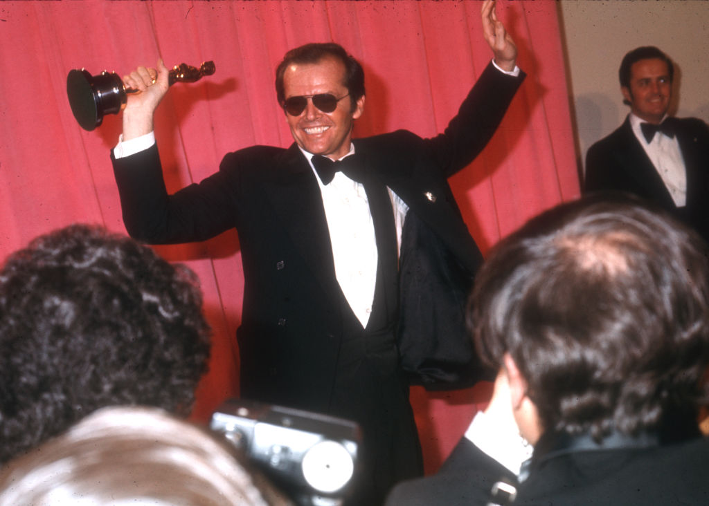 Jack Nicholson holding his oscar right after he won