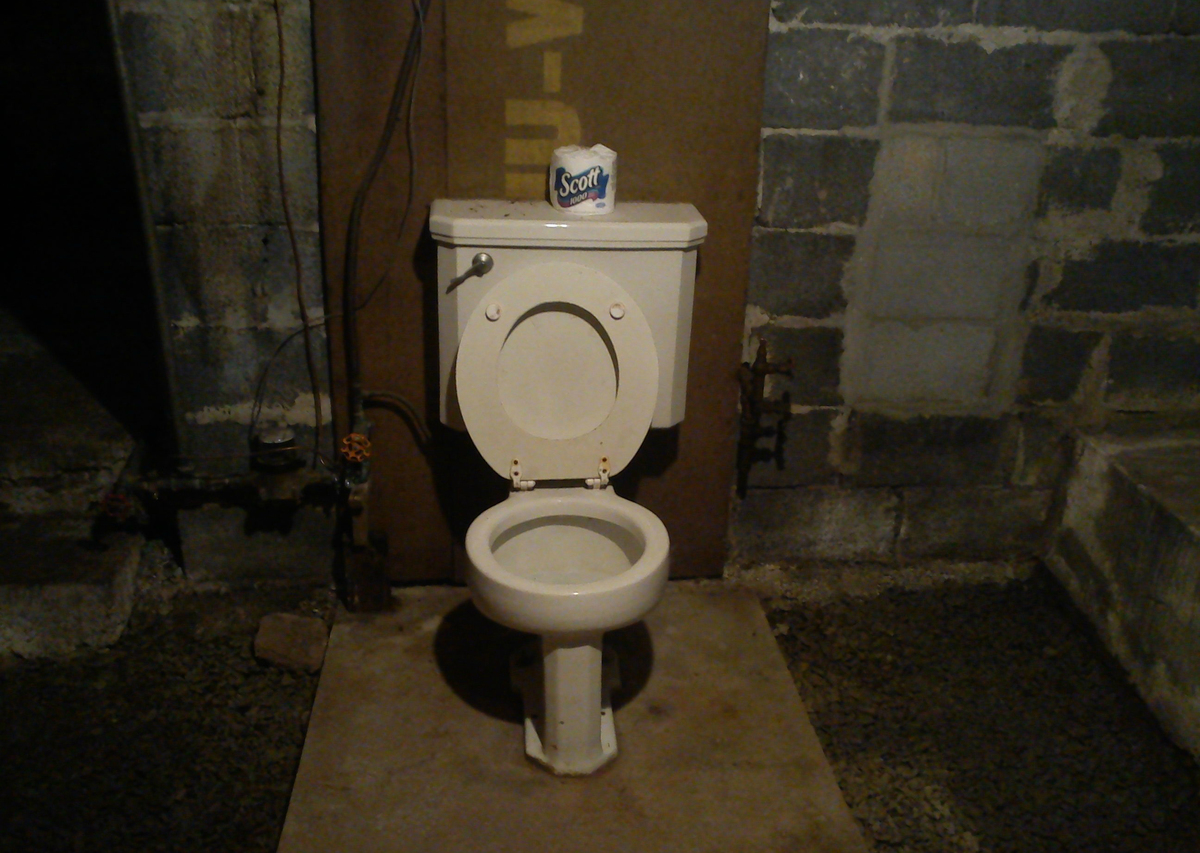 A Pittsburgh potty sits in the middle of a basement.
