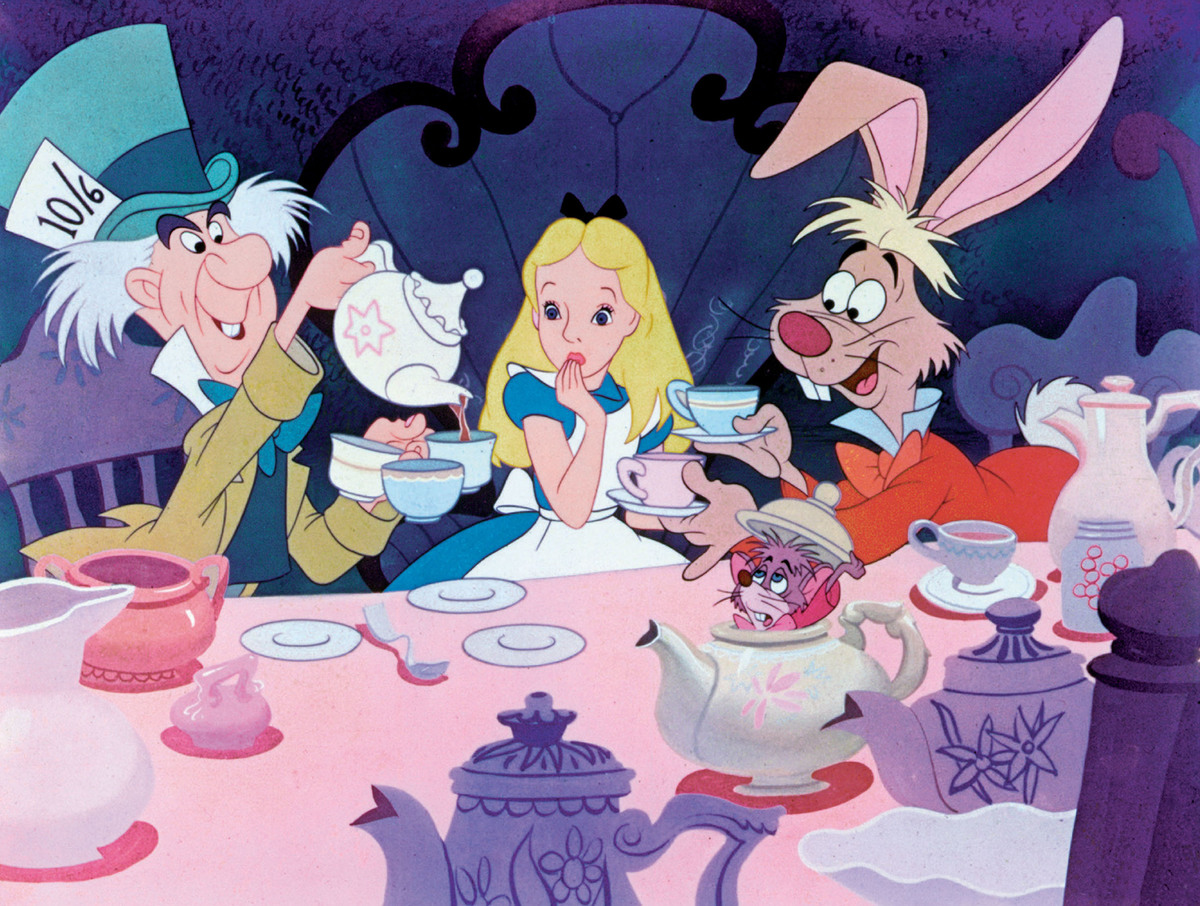Alice looks surprised while watching the Mad Hatter pour tea