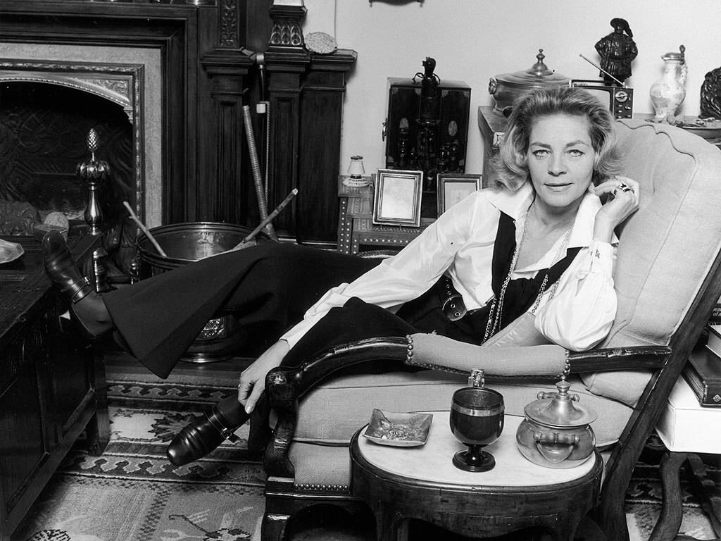 lauren bacall lounging in chair