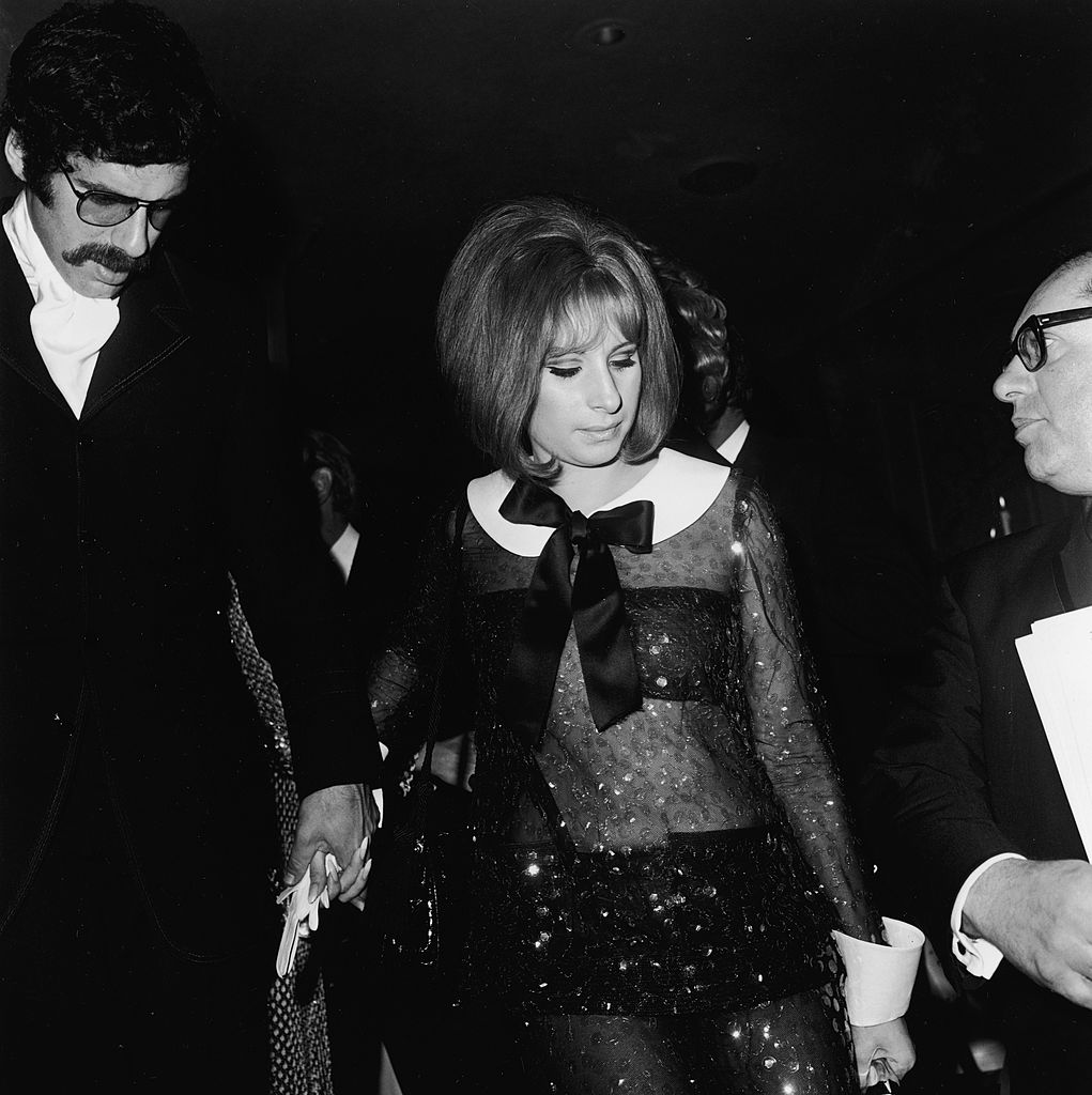 barbra streisand holding hands with elliott gould wearing a sheer black outfit