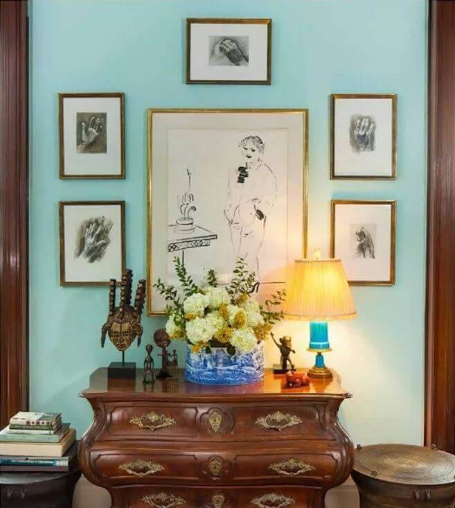 sketches framed above dresser in lauren bacall apartment