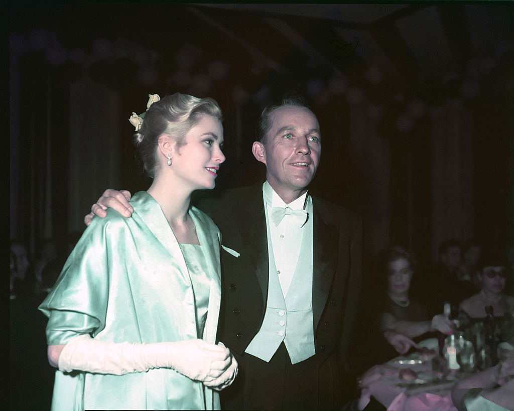grace kelly and bing crosby arriving at the academy awards in formal dress