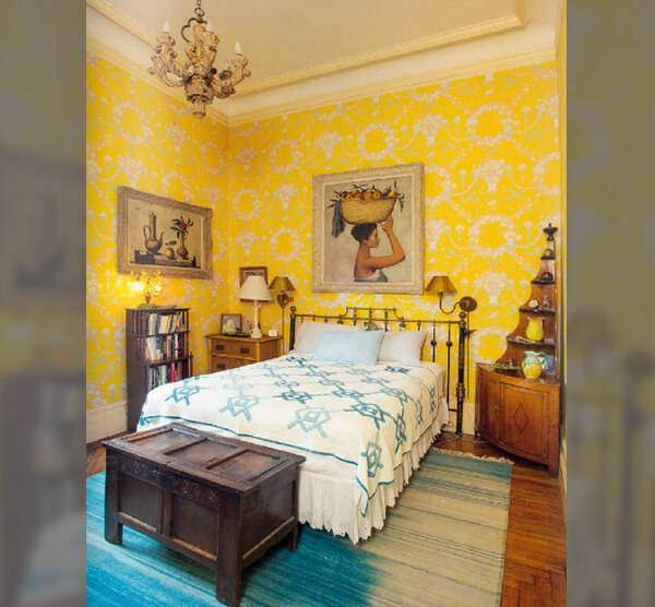 guest room with yellow walls in lauren bacalls apartment