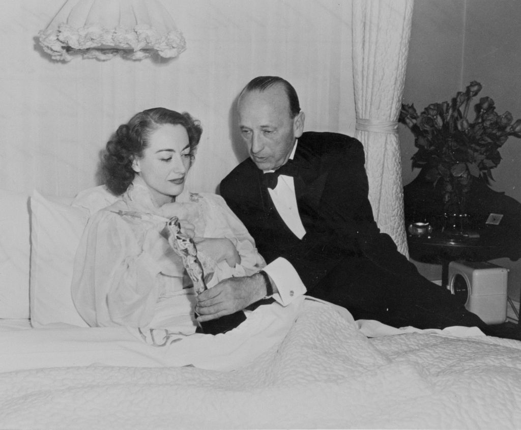 joan crawford accepting her oscar while sick in bed from michael curtiz