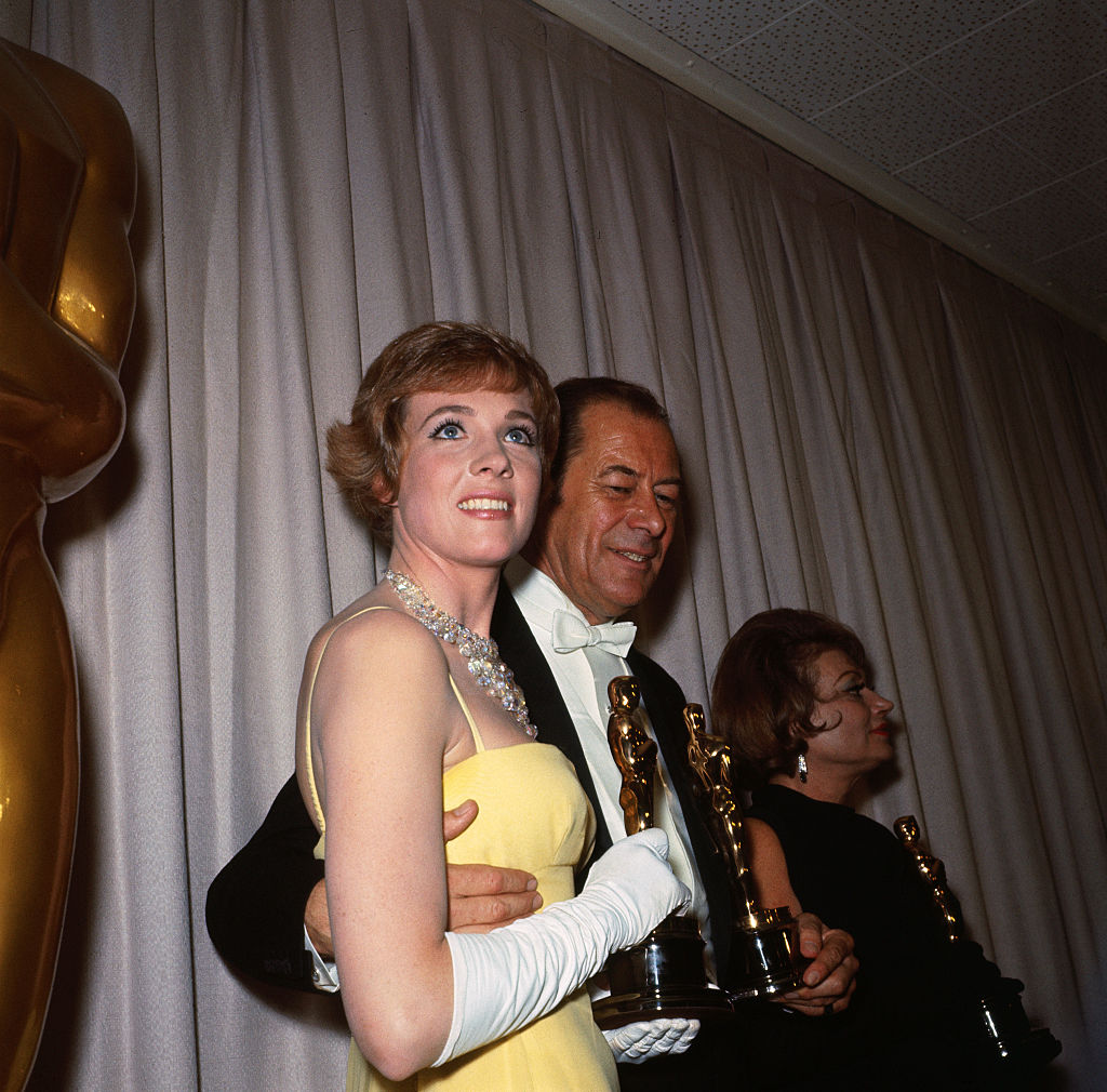 julie andrews and rex harrison with their oscar statues