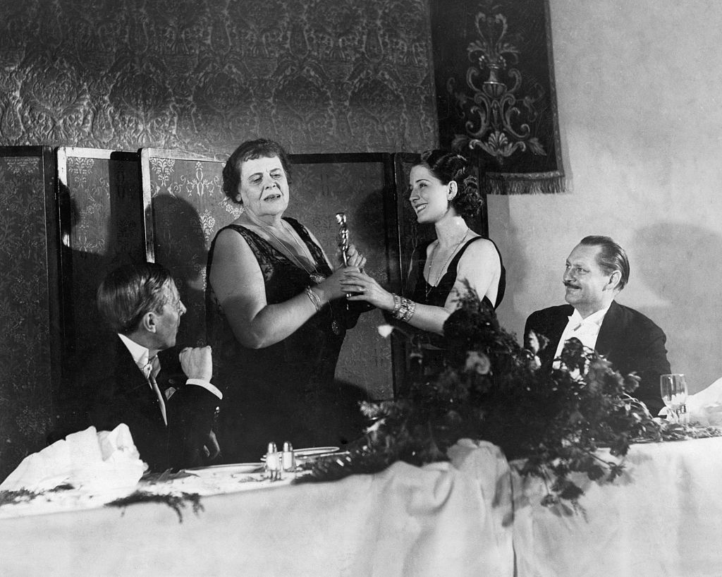 george arliss and norma shearer giving oscars to marie dressler and lionel barrymore
