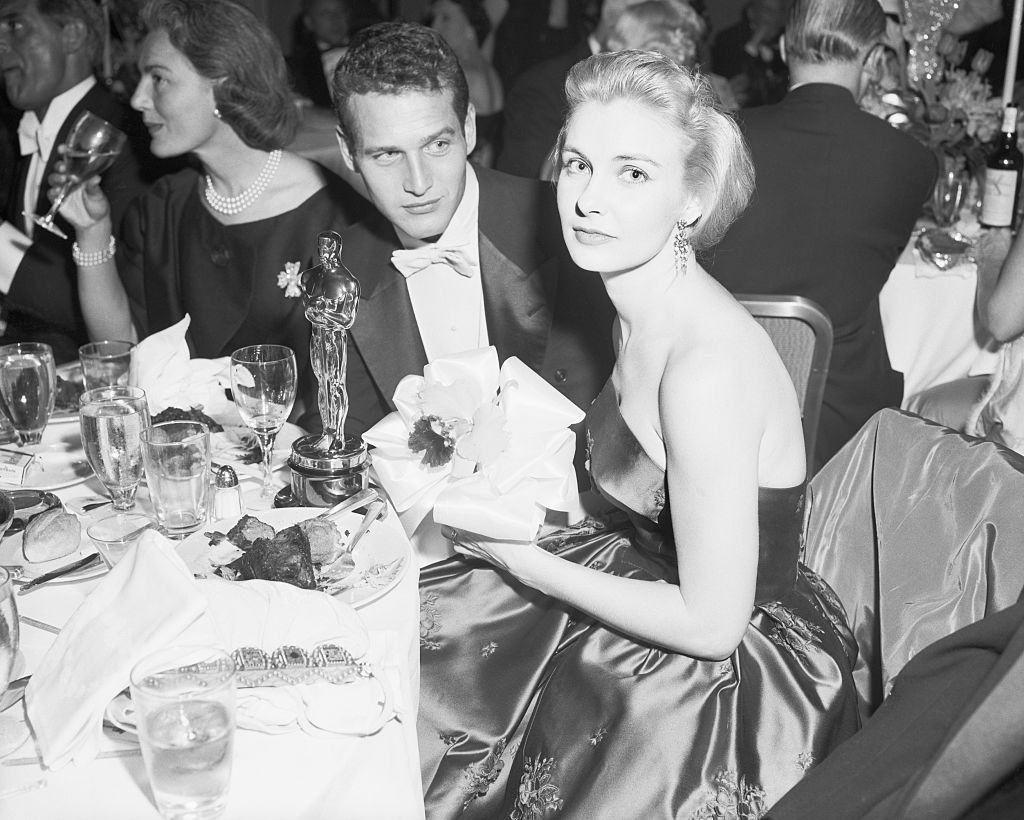 paul newman and joanne woodward sitting at a table after woodward won her oscar