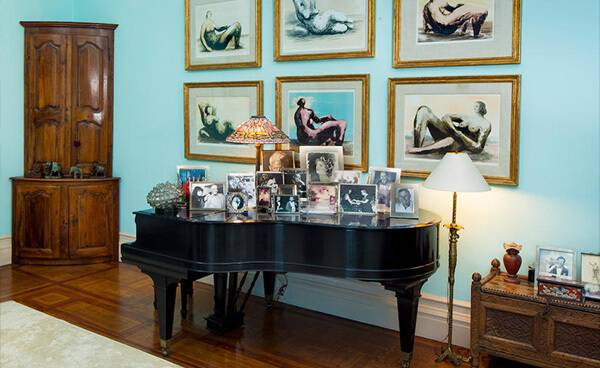 baby grand piano in formal living room