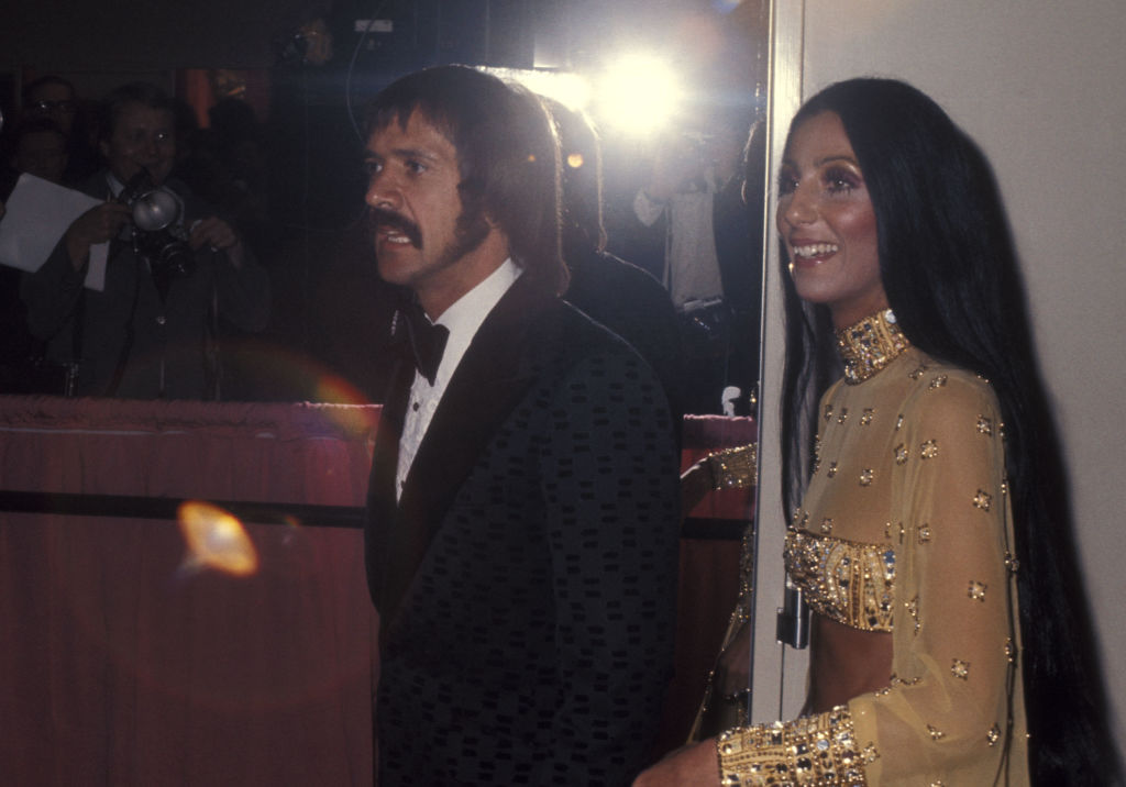 sonny and cher in front of the paparazzi