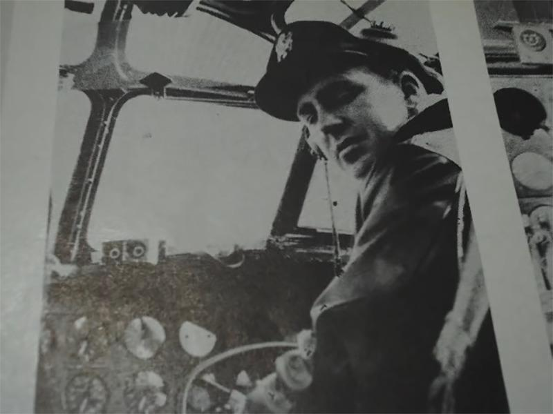 A black-and-white photo features Robert F. Turner, co-pilot of Lady Be Gone, sitting in the plane.