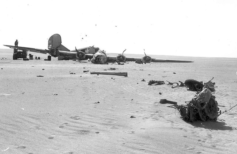 A far-away photo shows the crashed B-24D bomber Lady Be Good.