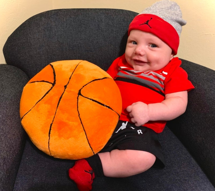 baby with a little basketball