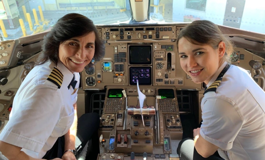 mother and daughter hanging out in pilot cockpit