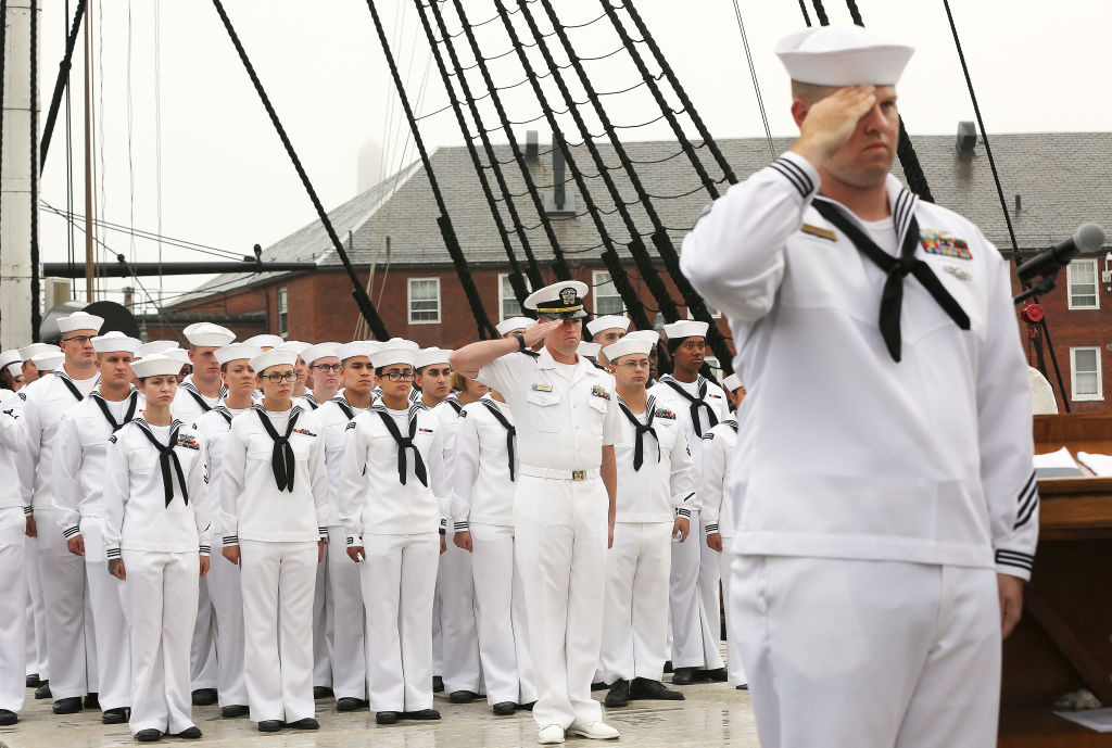 Sailors aboard the USS Constitution salute.