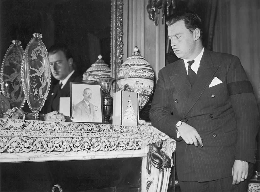 A mourning Duke looks at a photo of his late father.