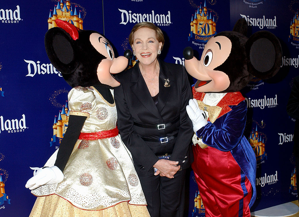 Julie poses with Mickey and Minnie at Disney's 50th anniversary.