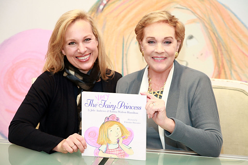 Julie and her daughter Emma pose with their book A Very Fairy Princess.