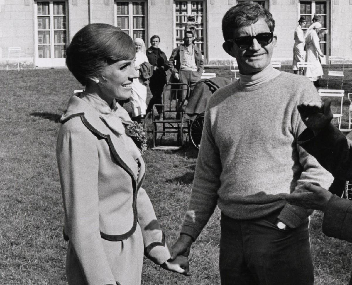 Andrews and Edwards hold hands while on set.