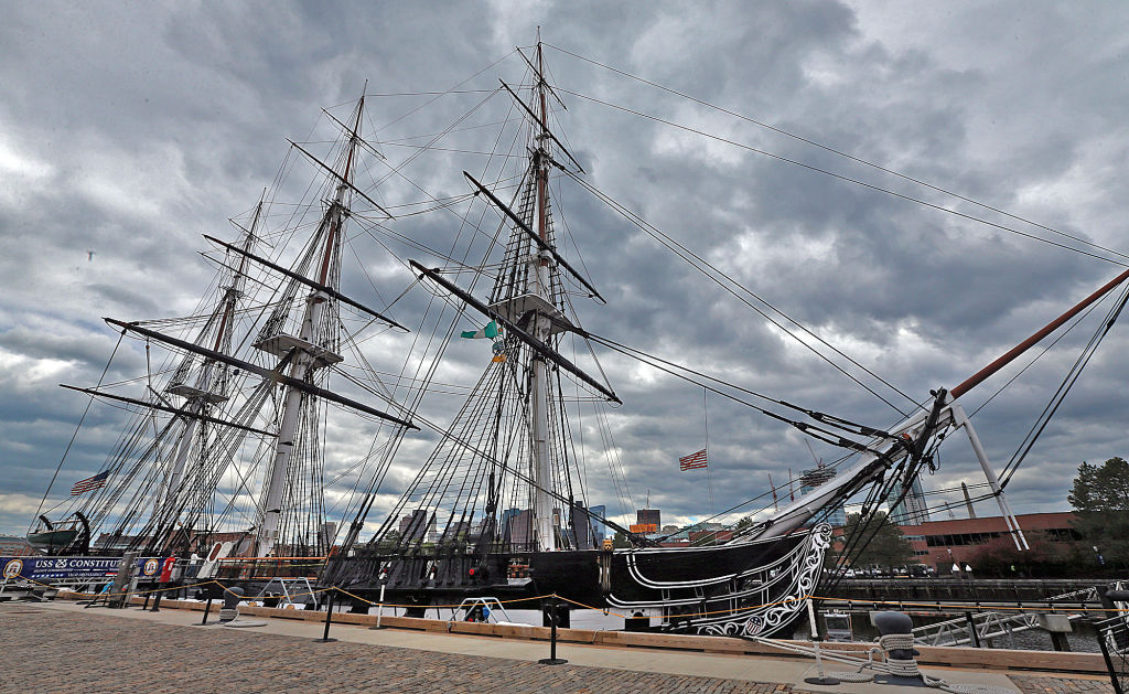 The large ship is illuminated by an overcast sky.