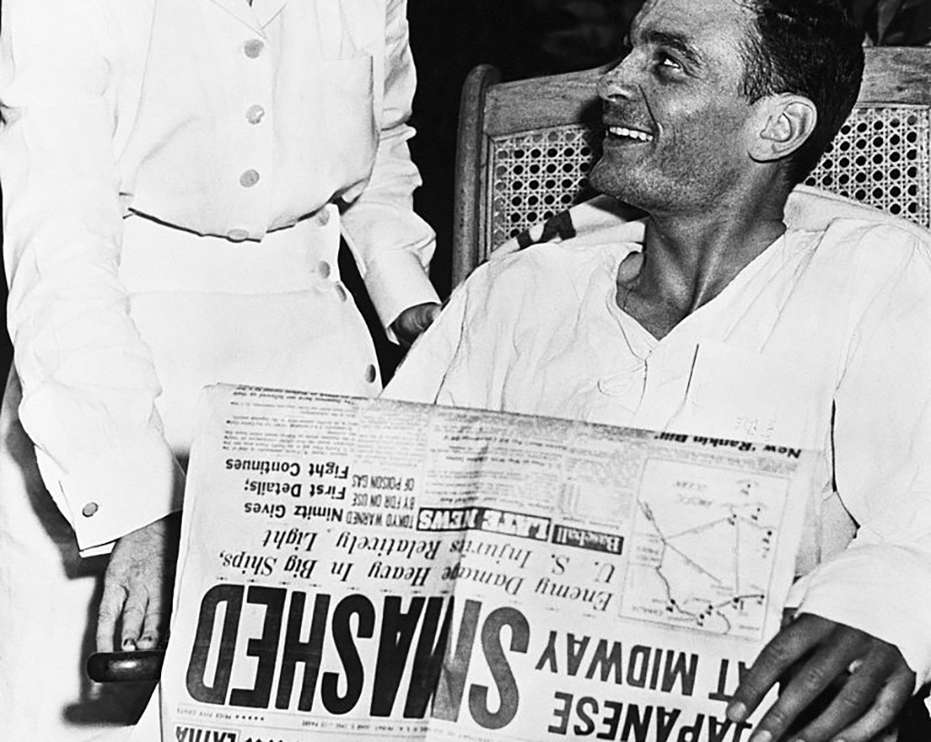 Man reading newspaper about the victory