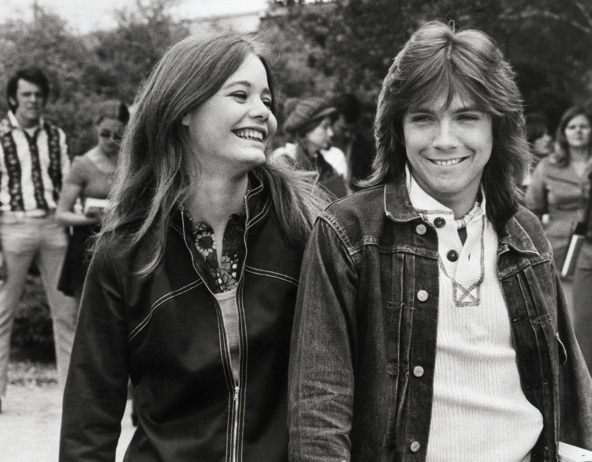 Susan Dey walks and shares a joke with her co-star David Cassidy.