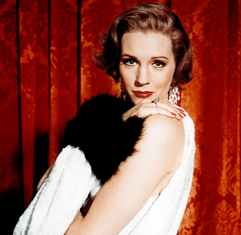 Julie Andrews poses while dressed like a flapper.