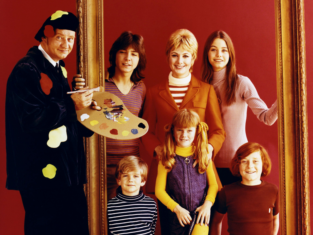 Partridge family poses inside a giant golden frame as Dave Madden