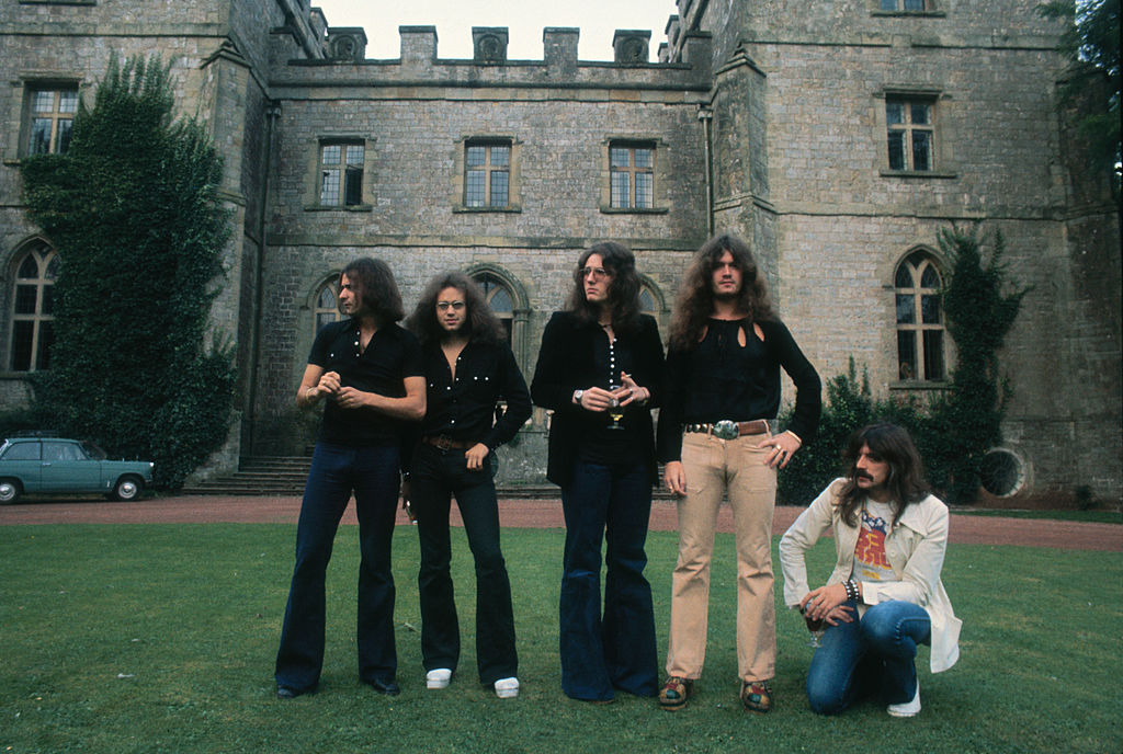 Deep Purple posing in front of an estate