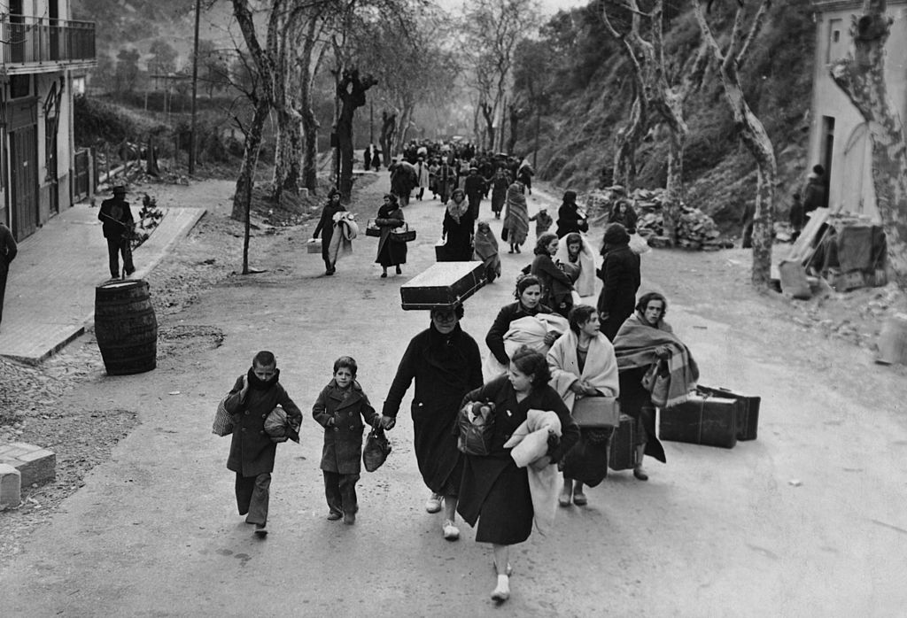 People carrying their belongings flee Paris in 1940.