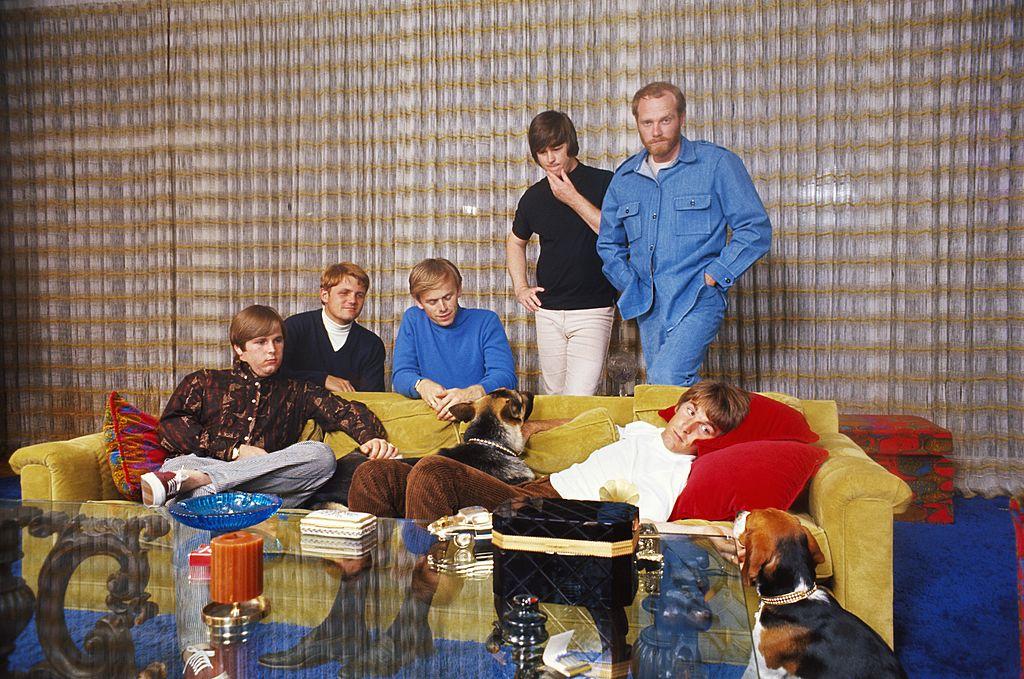 The Beach Boys posing in a house