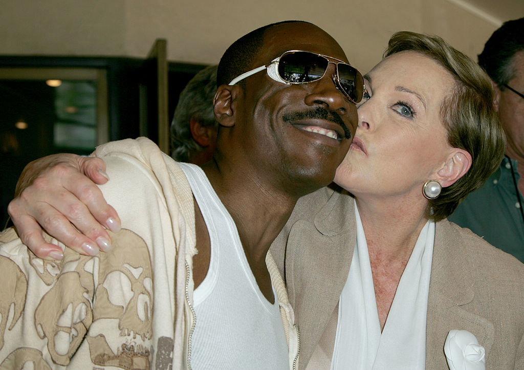 Julie Andrews plants a kiss on the cheek of Eddie Murphy.