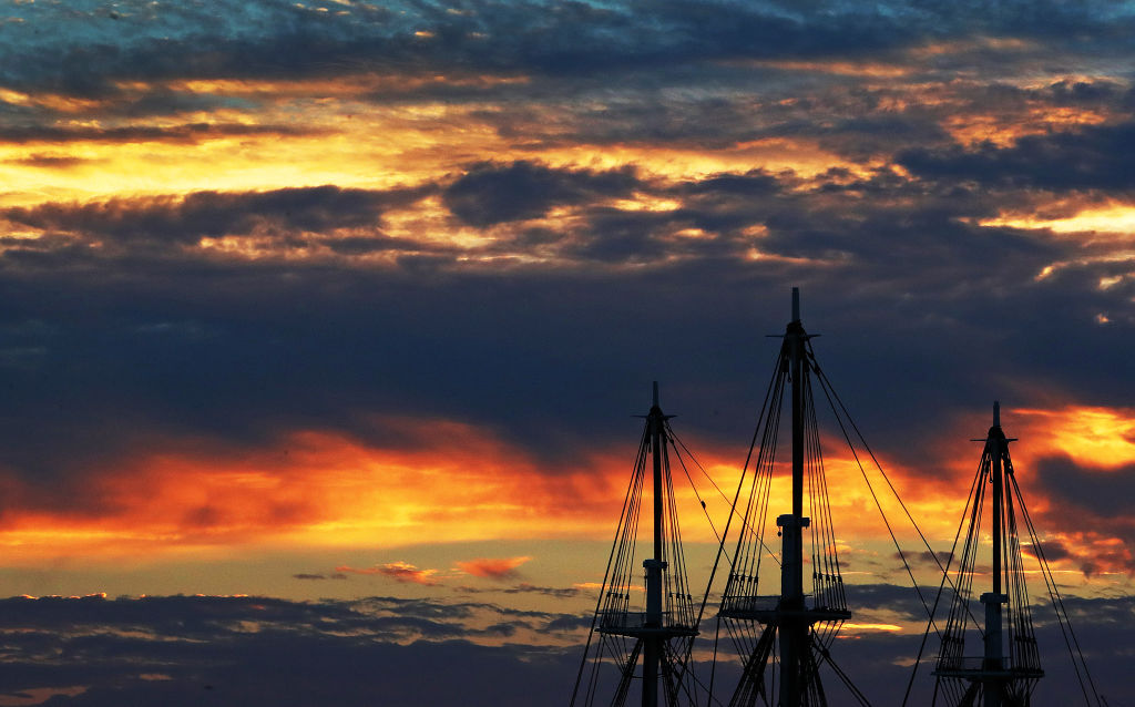 The sun set behind the USS Constitution.