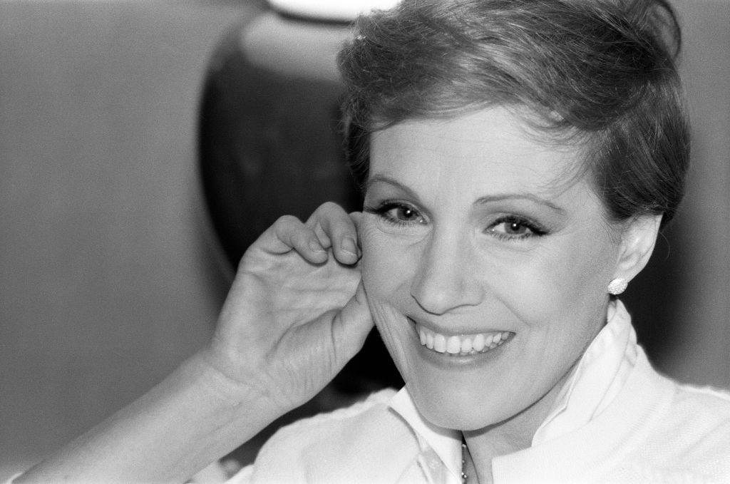 Julie smiles with a hand to her cheek in 1981.