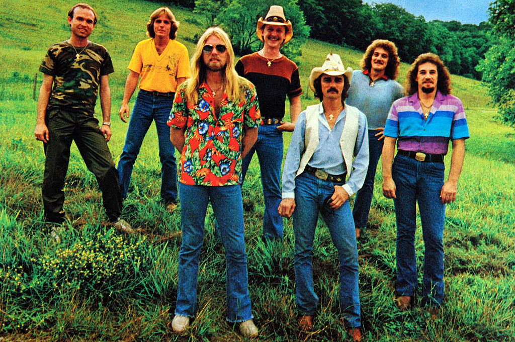 The Allman Brothers Band standing in a field