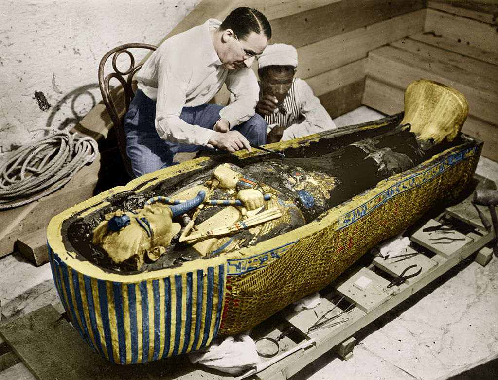 Howard Carter looking in sarcophagus