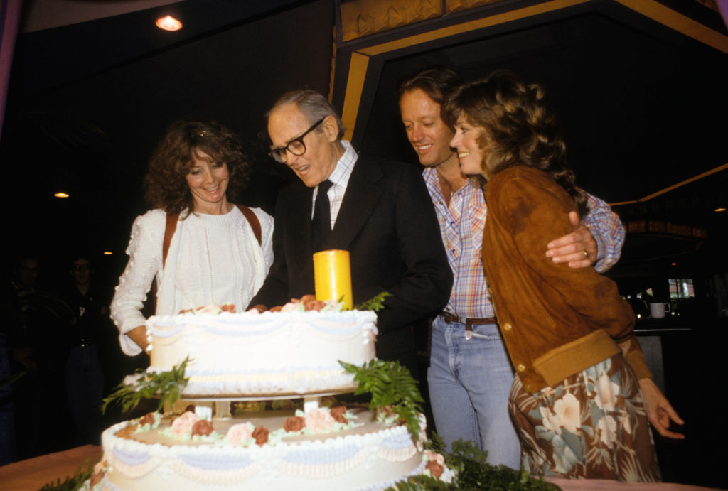 Henry Fonda and family cutting a cake
